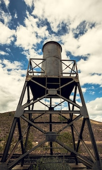 Water tank in the iron structure with the sky and mountain