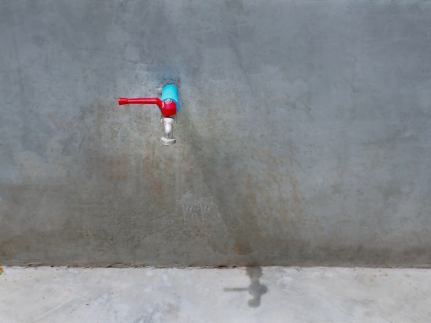 Water tap manual valve on cement wall