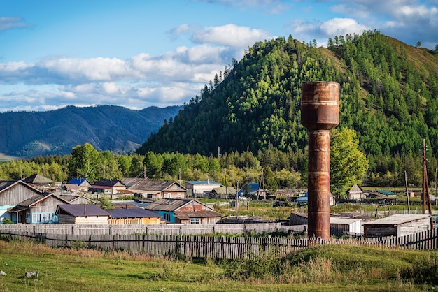 Water tower in a mountain village russia mountain altai village of tuecta