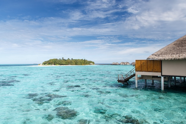 Water villa on crystal clear water on island