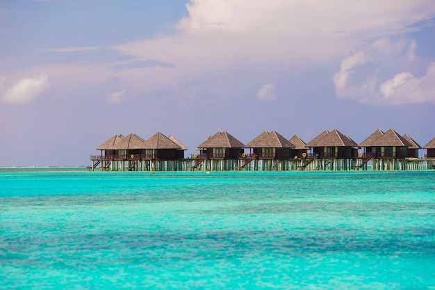 Water villas, bungalows on ideal perfect tropical island