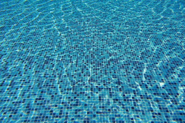 Water wave in swimming pool with light reflecting. texture background.