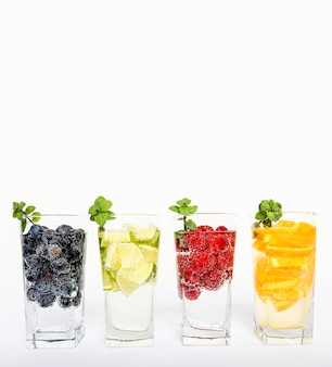 Water with fruit in glasses