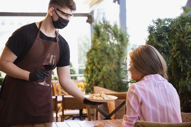Water with mask in restaurant, coronavirus outbreak