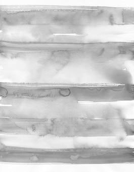 水彩の抽象的なグランジ背景、モノクロ、手描きのテクスチャ、水彩の汚れ。