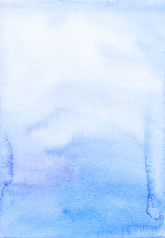 Watercolor blue ombre background hand painted. aquarelle sky blue texture.