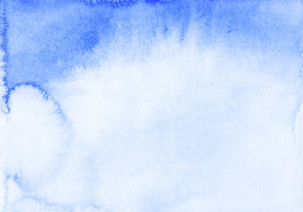Watercolor blue ombre background texture. watercolour deep blue gradient. stains on paper.