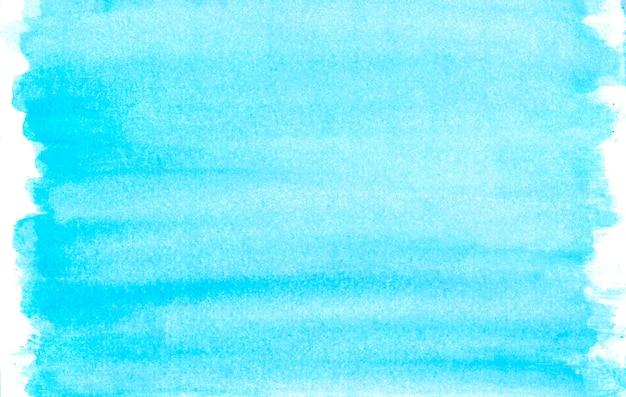 白い背景の上の水彩の青い塗抹標本