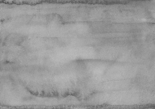 水彩の穏やかな灰色の背景テクスチャ。水の色古いモノクロ背景汚れ紙の上。
