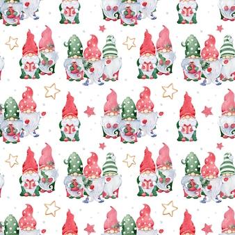 水彩画のクリスマススカンジナビアのパターン。緑と赤の帽子と金色の星のかわいいノームとのシームレスな背景。