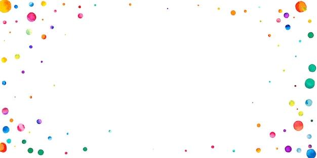 Акварельное конфетти на белом фоне. живые точки цвета радуги. счастливый праздник широкая красочная яркая карта. отличное конфетти, расписанное вручную.