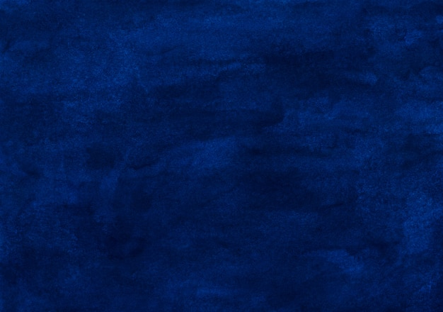 Watercolor dark blue background painting texture. vintage hand painted deep ocean blue watercolour background. stains on paper.
