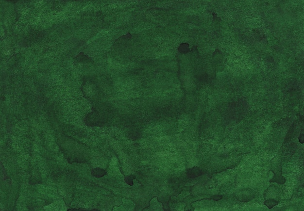 Watercolor dark green background painting. aquarelle deep grass green color . brush strokes on paper hand painted texture.