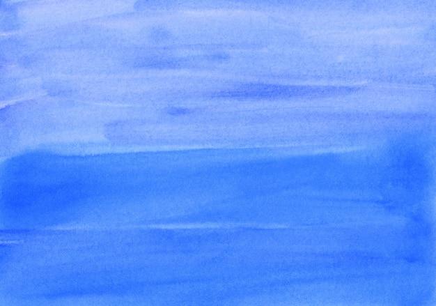 Акварель темно-синий фон текстуры ручная роспись. акварель небесно-голубой абстрактный фон. мазки по бумаге.