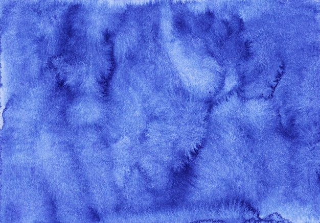 Watercolor deep blue background texture hand painted.  cerulean stains on paper.