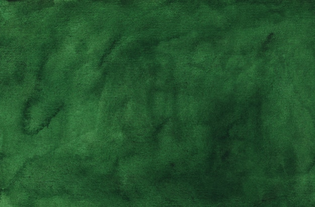 Watercolor deep green background texture painting. water color abstract dark spruce background stains on paper.