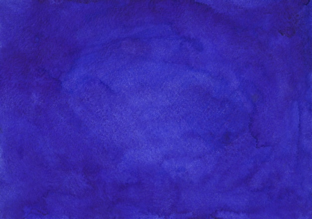 Watercolor deep indigo blue background texture hand painted. aquarelle stains on paper.
