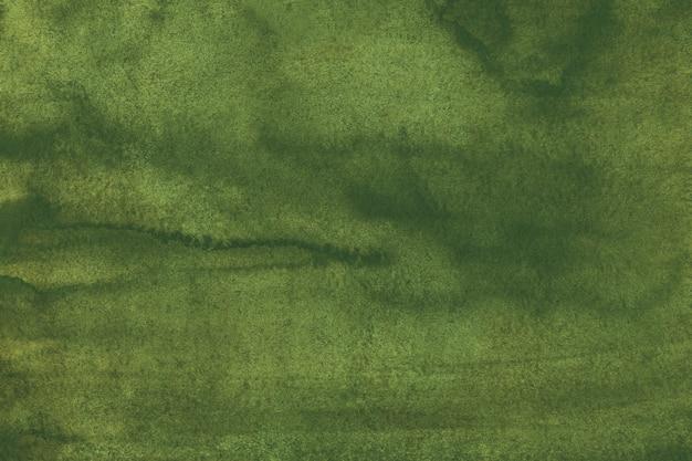 水彩の深いオリーブグリーンの背景のテクスチャ