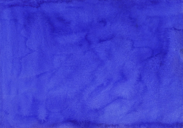 Watercolor deep royal blue background texture hand painted. aquarelle blue stains on paper.