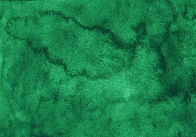 Акварель изумрудный фоновой живописи. акварель абстрактный глубокий зеленый фон. пятна на бумаге.