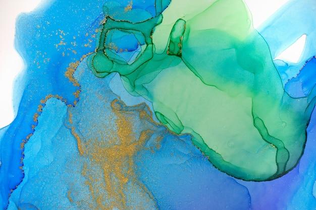 수채화 녹색 및 파랑 추상 얼룩 배경. 잉크 그라데이션 텍스처.