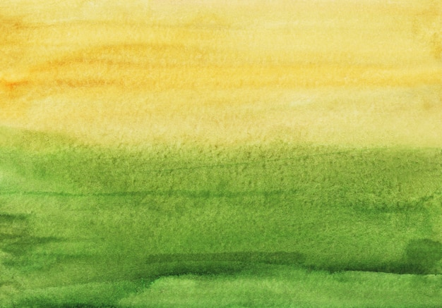 水彩の緑と黄色の背景の絵。抽象的な水の色のテクスチャです。