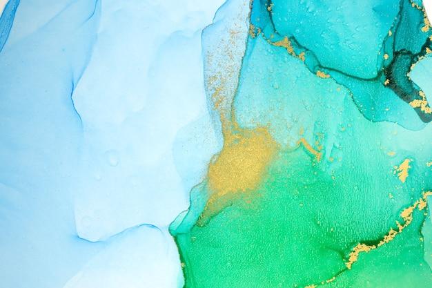 수채화 녹색 파란색과 금색 그라데이션 추상 얼룩 배경