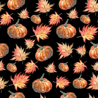 Watercolor halloween pattern of autumn leaves and pumpkins on black background