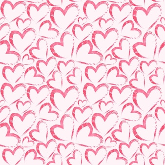 Watercolor hand drawn seamless pattern with hearts on light pink surface
