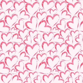 淡いピンクの表面にハートと水彩の手描きのシームレスなパターン