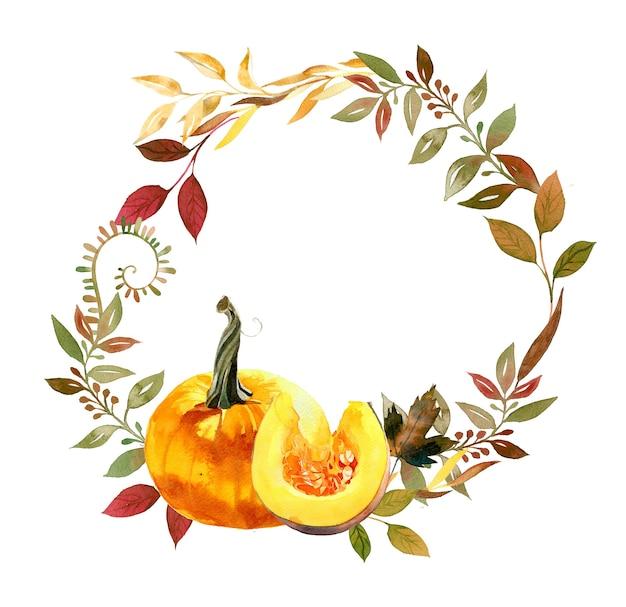 水彩の手描きの秋のカボチャと葉の花輪のイラスト