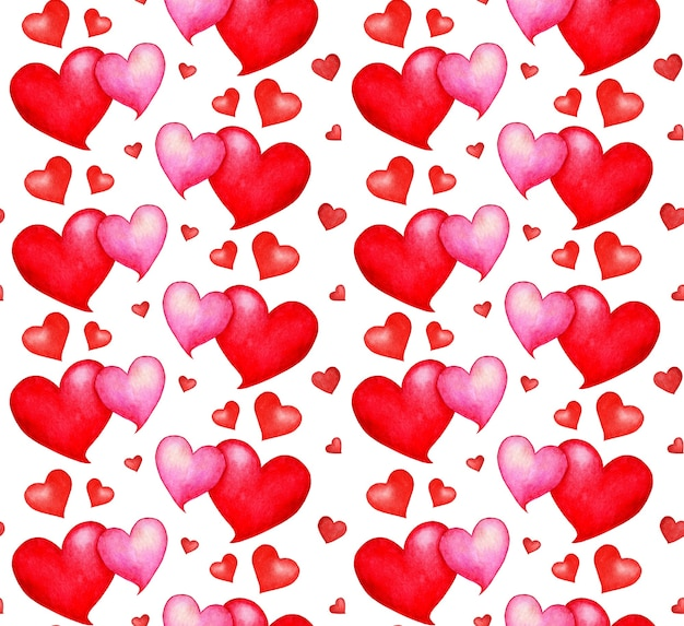 원활한 심장 패턴의 수채화 그림입니다. 빨간색과 분홍색 하트가 끝없이 반복됩니다. 발렌타인 데이