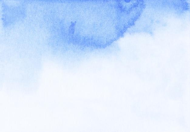 水彩の明るい青と白のグラデーション背景テクスチャ。アクワレル液体抽象的な青い背景。手描き