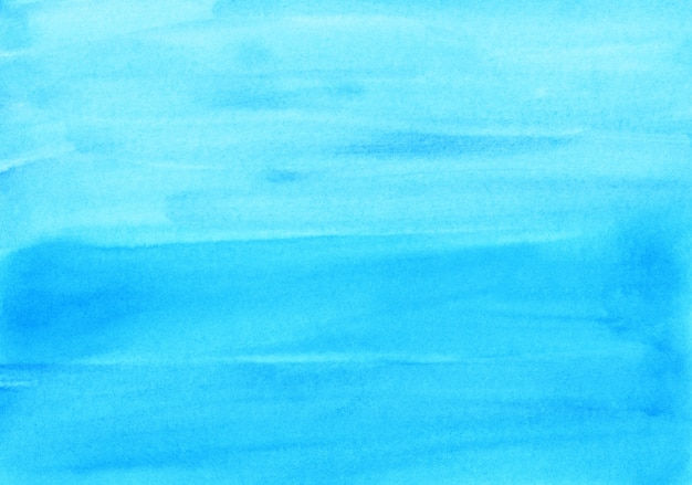 Акварель светло-голубой фон текстуры ручная роспись. акварель ярко-бирюзовый абстрактный фон. мазки по бумаге.
