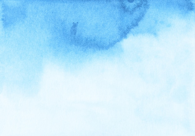 Watercolor light blue gradient background texture. stains on paper, hand painted