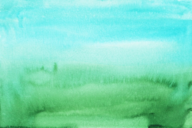 Watercolor light blue and green gradient background texture. multicolored soft ombre , hand painted. stains on paper.