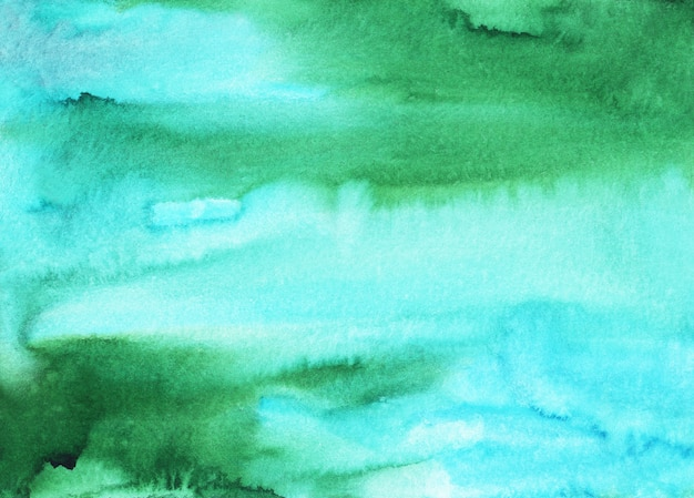 Watercolor light blue and green stains background texture. multicolored soft watery , hand painted.