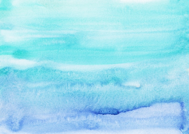 Watercolor light cyan blue background painting. water color bright sky blue stains on paper. watery texture.