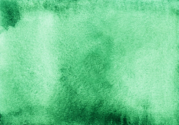 Watercolor light emerald ombre background texture.