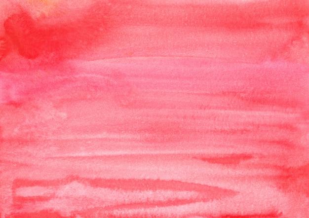 水彩の明るい赤の背景テクスチャ手描き。紙の上のピンクの赤い芸術的な背景の水の色のブラシストローク。