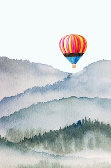 Watercolor mountain background drawn by brush colorful paints hot air balloon on paper texture