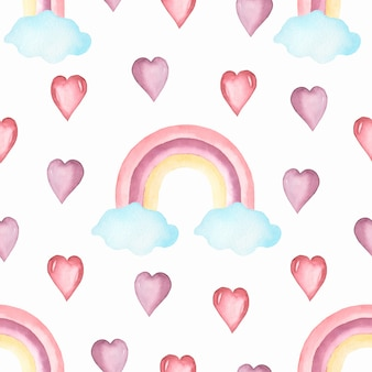 Watercolor nursery  seamless pattern with hand painted rainbows .