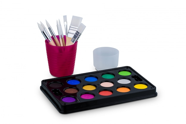 Watercolor paint set and paintbrush isolated