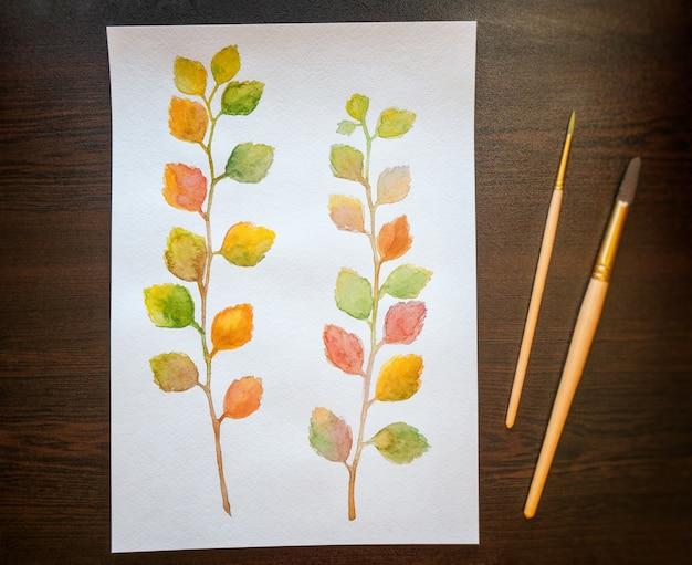 Акварельная живопись красочные осенние листья. вид сверху