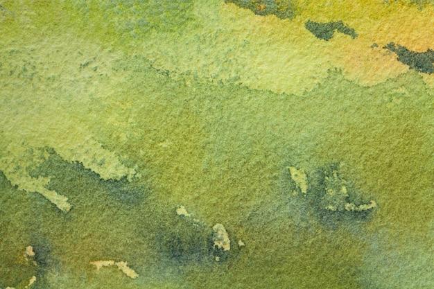 黄色の汚れとグラデーションでキャンバスに水彩画
