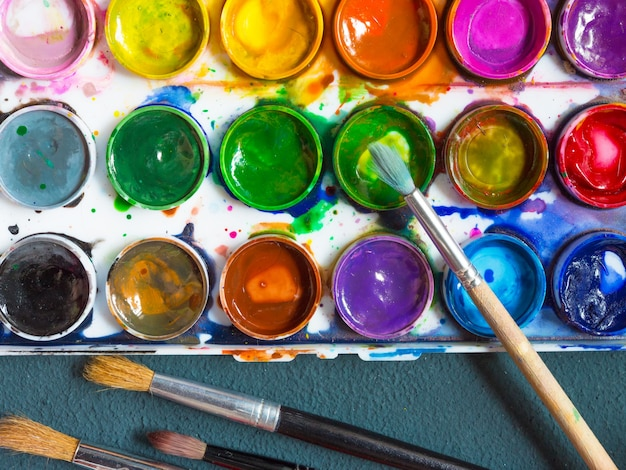 Watercolor paints, artistic brushes, palette of accessories for the artist