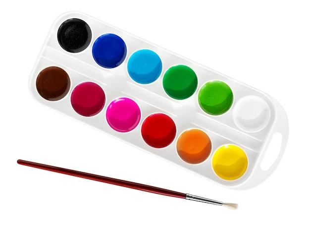 白い背景で隔離のボックス内の水彩絵の具。水彩絵の具、ペイント用ブラシのセット。