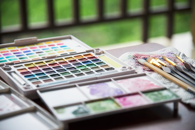 Watercolor palette box with brushes set
