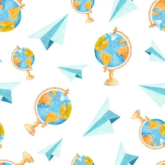 Watercolor paper airplanes and school globes seamless pattern.