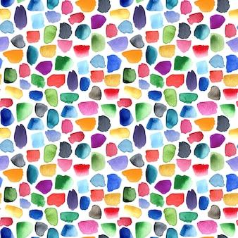 赤、青、緑、黄色、ピンク色のカラフルなブラシストロークの水彩パターン。